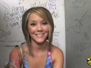 "petite tattooed teen licking black balls at a glory hole"" target=""_blank"