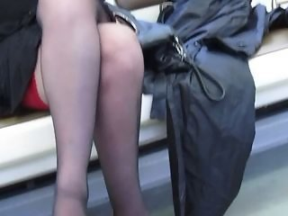 Black stockings yon red tops in train
