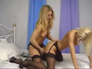 British lesbians in strap-on action in stockings