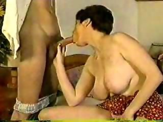 Russian slut with big boobs gives blowjob
