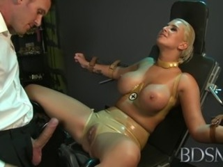 Master straps big tits submissive girl to a gyno chair and pleasures her
