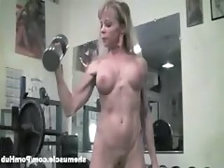 busty buff mature blonde flexes her muscled vagina in the gym