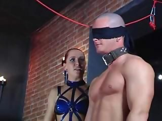 Busty slave is tied up and given to another slave to fuck her