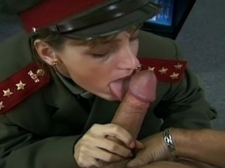 Brunette slut in uniform is having a huge white cock in her mouth, giving...