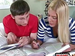 Stepmom teaches teen how to work a cock