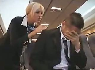 Blonde babe flight attendant gives a guy a handjob