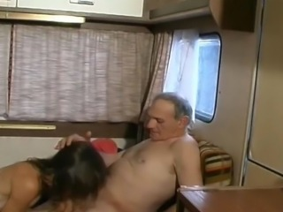 Mature couple fucks in the trailer.
