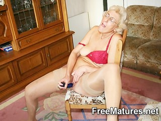 Grandmom In Pantyhose Masturbating With Dildo