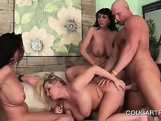 Dick starved cougars gets peachy cunts banged in foursome