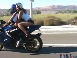 Gianna Lynn teases on the back of a motorcycle
