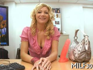 "Arousing blonde milf strips her sexy clothes"" class=""th-mov"