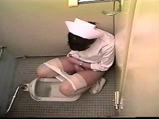 Nurse masturbates in a toilet...