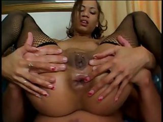 Perfect young exotic girl in fishnets takes on two big dicks in all...