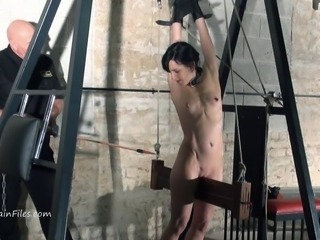 Explicit electro sadism and wooden device roped of serf Elise Grave inside...
