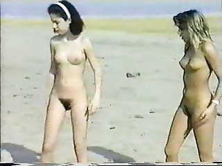 2 naturists teens play on the beach