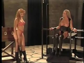 Busty blonde gets flogged by dominatrix