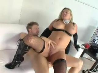 Dirty blonde in fishnet stockings and boots takes dick up he...