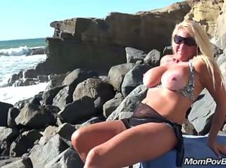 Busty blonde MILF public beach flashing