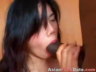 Chinese girl is getting manhandled by a big black cock in all holes