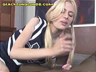 Skinny blonde teen cheerleader in pigtails fucks a black cock