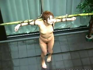 Asian Ginger Crucified And Tortured Around Water