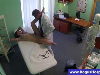 Brunette patient getting oral from their way doctor