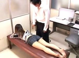Kinky doctor fingers a palatable Japanese MILF