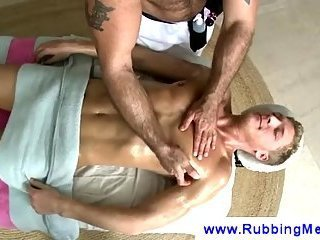 Masseuse puts a toy in a gay ass