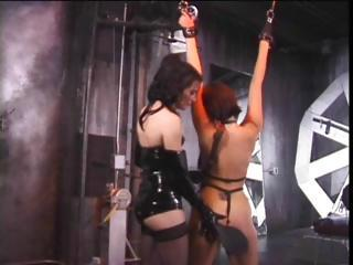 Two Latex Clad Lesbians To The Slave Mas...
