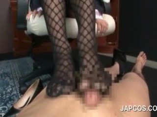 Japanese office lady in fishnets giving a hot footjob