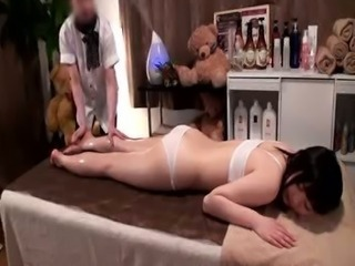Performing Oil Massage To Teen Slut