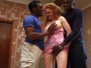 Two well hung men fuck a redheaded milf.