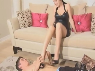 Young brunette mistress perform trampling on male  Visit her site now!