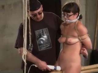 Dungeon Master Ties Up Submissive Brunette and makes her cum with sex toys