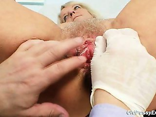 Granny white-headed Dorota gets her hairy pussy gyno checked