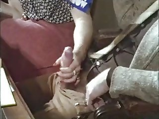 Guy gets a handjob in a retro vintage porno