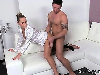 Muscled tattooed guy fucks female agent on couch