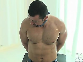 Muscle man is training but feels the need to stroke his cock