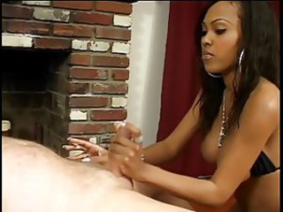 Old white guy lies back and gets a handjob from ebony hottie