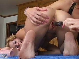 Barefoot lesbians are having kinky in the kitchen nearby big dildos