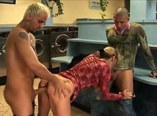 Double penetration of hot babe in launderette.