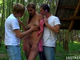 Hot teen brunette is tied up for wild drillings with two studs