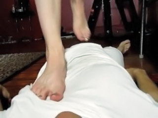 Mistress gives administers CBT and Trampling superior to before her slave