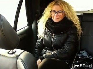 Curly haired blonde fucking in fake taxi in public