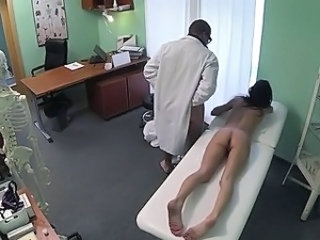 Doctor fucks brunette and cums above her pussy in sanitarium