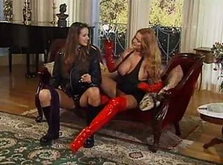Milf in red boots and gloves has hard lesbian sex with teen tart in...