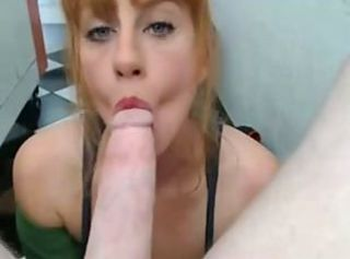 Redhead deepthroats huge cock behind counter of shop