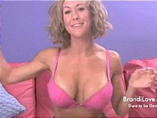 Sexy busty blonde MILF Brandi Love strips and poses and plays with her dildo