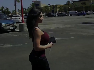 Denise Milani walking down the street