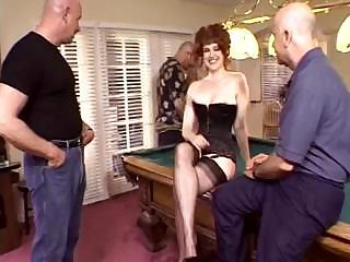 Mature Redhead Is Getting Slammed By Two Dudes On Billiard Table